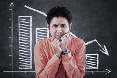 Frustrated man and falling graph Royalty Free Stock Image