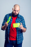 Frustrated man with green gift box Stock Photography