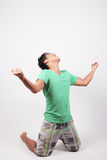 Frustrated man on his knees stock photo