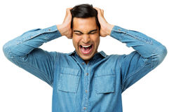 Frustrated Man Holding Head In Hands Royalty Free Stock Photos