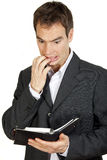 Frustrated man looking at his diary Stock Image