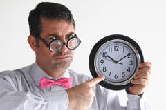 Frustrated man manager points to the time on a clock Stock Image