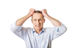 Frustrated man pulling his hair Stock Photo