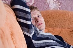 Frustrated man resting on a couch Stock Photography