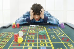 Frustrated Man At Roulette Table Stock Photo