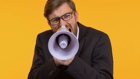 Frustrated man screaming in megaphone calling to action, searching support. Stock footage stock video footage