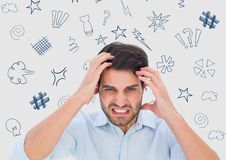 Frustrated man standing with graphics over head Royalty Free Stock Photo