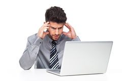 Frustrated Man Staring at Laptop Screen Stock Photography