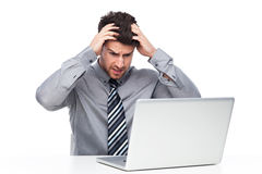 Frustrated Man Staring at Laptop Screen Royalty Free Stock Images