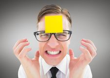 Frustrated man with sticky note on his forehead Royalty Free Stock Photography