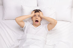 Frustrated man unable to get some sleep Stock Photos