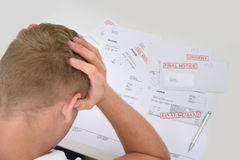 Frustrated Man With Unpaid Bills Royalty Free Stock Images