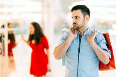 Frustrated man waiting for spouse Stock Images