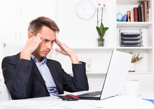 Frustrated man working on laptop Royalty Free Stock Images