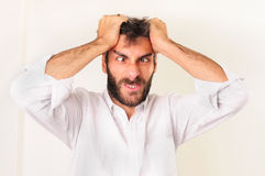 Frustrated Man Yelling. And holding his head Royalty Free Stock Photography