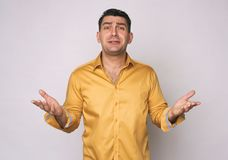 Frustrated man in yellow shirt isolated Royalty Free Stock Photos