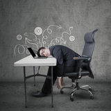 Frustrated manager sleeping on laptop at desk Royalty Free Stock Image