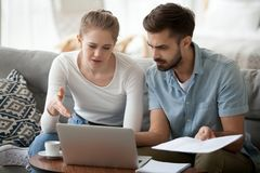 Frustrated married couple has financial problems received bad ne. Frustrated married couple has financial problems wife and husband received bad news from bank stock photo