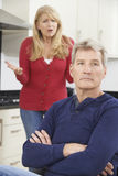 Frustrated Mature Couple Having Arguement At Home Stock Image