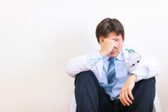Frustrated medical doctor sitting on floor Royalty Free Stock Photography