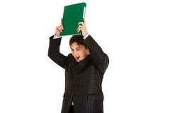 Frustrated modern businessman brandishing folder Stock Images