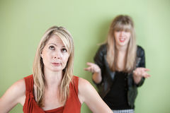Frustrated Mom. Disappointed mom with frustrated daughter in background Stock Images