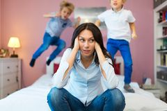 Frustrated mother with children  stock photo