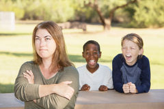 Frustrated mother with children at park Royalty Free Stock Photography