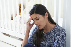 Frustrated Mother Suffering From Post Natal Depression Stock Image