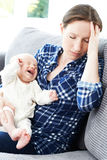 Frustrated Mother Suffering From Post Natal Depression. Frustrated Mother Suffers From Post Natal Depression Royalty Free Stock Images
