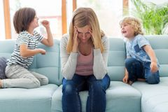 Free Frustrated Mother With Children Stock Image - 149300371