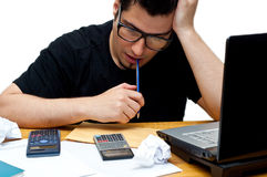 Frustrated nerdy accountant Stock Images