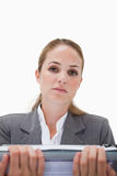 Frustrated office employee with pile of paperwork Royalty Free Stock Photos