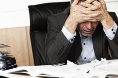 Frustrated office manager overloaded with work. Stock Photos