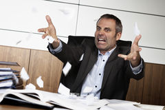 Frustrated office manager tearing document. Royalty Free Stock Photos