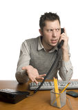 Frustrated office worker on the phone Stock Images