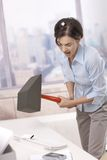 Frustrated office worker smashing keyboard Stock Image
