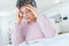 Frustrated old lady has pain in head. Old stock photography