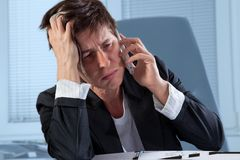 Frustrated phone call Stock Photo