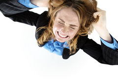 Frustrated pretty brunette tearing her hair out Stock Photos