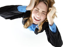Frustrated pretty brunette tearing her hair out Stock Images
