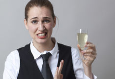 Frustrated 20s girl resisting in drinking more Champagne at party Stock Photography