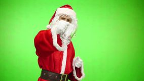 Frustrated Santa Claus with an empty beer glass. chromakey
