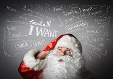 Frustrated Santa Claus and many wishes. Stock Photography