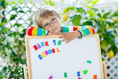 Frustrated school kid boy is back to school Stock Photos
