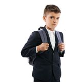 Frustrated schoolboy with schoolbags Stock Images
