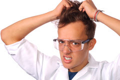 Frustrated scientist pulling his hair Royalty Free Stock Photography