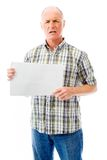 Frustrated senior man holding a blank placard Royalty Free Stock Photos
