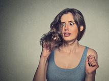 Frustrated shocked young woman unhappy with her new hair cut Stock Photography