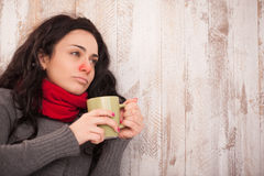 Frustrated sick girl with cup Stock Photos